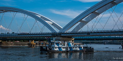2018 - Serbia - Danube - Žeželj Bridge - 1 of 2 (Ted's photos - For Me & You) Tags: 2018 cropped nikon nikond750 nikonfx novisad serbia tedmcgrath tedsphotos vignetting žeželjbridge žeželjbridgenovisad novisadserbia bridge boat ship tug orasac opawaii river danuberiver water bridgespan blue bluesky