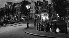 Amsterdam. (alamsterdam) Tags: amsterdam monochroom reflection picture longexposure bridges cars bikes architecture boats sky