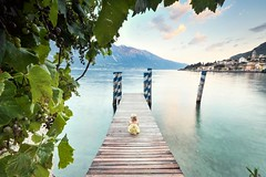 Little girl (Zscherny) Tags: girl child long exposure teal blue sky clouds pier beach lake water mountain sundown nature digital nikon landscape landscapephotography landschaft langzeitbelichtung photography limone lago gardasee di garda italy italia