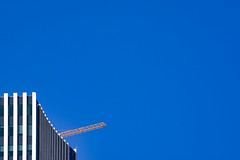 Top of the Morning... (Mister Day) Tags: minimal crane blue sky skyscraper downtown edmonton