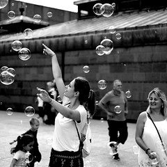 I saw her standing there (HollandJoanne) Tags: flickrfriday isawherstandingthere people street bubbles seifenblasen blackandwhite