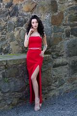 Dressed in red (piotr_szymanek) Tags: ika ikak portrait outdoor woman young skinny red dress legs highheels face stone wall tatoo longhair brunette 1k 20f 50f 5k 10k 20k 100f