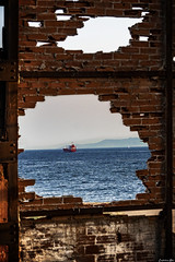 Sea Through... (Constantinos_A) Tags: sony alpha a6300 drapetsona machine athens fertilizing factory rust iron pressure old room abandoned industrial decay bricks wall sea ship clear sky