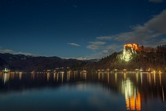 0809 Partly Cloudy Night On The Bled Lake (Hrvoje Simich - gaZZda) Tags: landscape outdoors noperson sky clouds blue stars water lake pond longexposure building castle lights reflections travel slovenia bled europe night dark nikon nikond750 nikkor283003556 gazzda hrvojesimich
