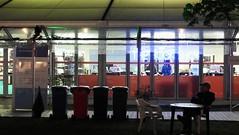 Book Festival After Dark 01 (byronv2) Tags: edinburgh edinburghfestival edinburghbynight festival charlottesquare newtown edimbourg scotland street candid peoplewatching night nuit nacht eibf eibf2018 edinburghinternationalbookfestival2018 edinburghinternationalbookfestival literature literaryfestival table chair standing sitting