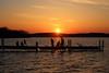 Sunset on the pier (danielhast) Tags: madison sunset lake mendota water sky pier people silhouette