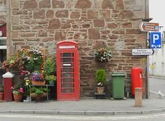 Red Telephone Box, Fortrose, Black Isle, July 2018 (allanmaciver) Tags: red telephone box fortrose black isle scotland colours plants green bin letter royal mail british telecom parking centre iconic allanmaciver