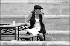 Table for one. (* RICHARD M (7.5 MILLION VIEWS)) Tags: street candid mono blackwhite portraits portraiture streetportraits streetportraiture candidportraits candidportraiture alone cap tableandchair seated sitting clothcap fingerwagging drink drinking expressions handbag cigarette smoker smoking cigarettsmoker liverpool merseyside scouse liverpudlian scousers merseysiders earrings hoopearrings necklace table bench tipsy characters