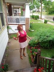 Yep, That's Rain Alright! (Laurette Victoria) Tags: rain sidewalk laurette woman redhead curly skirt milwaukee