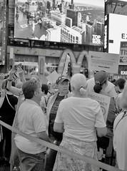 Confront Corruption: Demand Democracy (triebensee) Tags: bronica rf645 zenzanon 60mm f4 fujifilmneopanacros100 fujifilmneopanacros fujifilmneopan epsonv700 adox rodinal adonal selfdeveloped film blackandwhite mediumformat 120 6x45 rangefinder 150 dilution 24 celcius 8 minutes timessquare