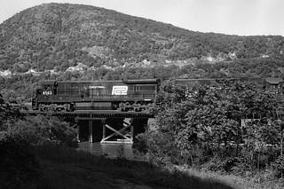 CR U33c 6563 (ex-PC) and GP38-2 8033 (ex-PC) north bound Iona Trestle, Summer 1976