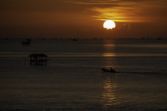 Fishing Boat in Sunrise (tanongsak.s) Tags: boats sunrise sun sunset sunlight sundown sunny seascape ocean fisherman fishing hut thailand asia morning light skyline clouds drive red yellow orange