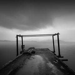 Old pier II (ilias varelas) Tags: sky sea seascape square seafront clouds blackandwhite bw greece mood mono monochrome mist light landscape longexposure atmosphere pier