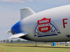 Zeppelin over Indiana (mrgraphic2) Tags: german brand farmersinsurance blimp airship sign indianapolis indiana zeppelin logo fin dirigible