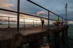 Catch Of The Day (OzGFK) Tags: australia dromana morningtonpeninsula nikond90 d90 fisherman fishermen fishing sunset winter cold pier jetty portphillipbay people urban streetphotography evening dusk clouds cloudy