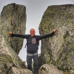 "I don't normally do ""selfies"" or portrait shots but this was taken earlier as both myself and John reached the top of Tryfan. Here i am between the iconic Adam and Eve rocks at the summit. Very misty and low cloud conditions but the perseverance payed off (L A H Photography) Tags: tryfan me walking hiking"