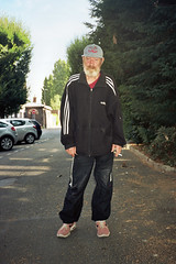 Dany (michel nguie) Tags: michelnguie film analog man beard portrait vertical tourcoing trees parking cars adidas casquette survet cigarette
