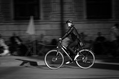 Riding into the light (michael.mu) Tags: germany leica m m240 munich bicycle motionblur leicasummaritm90mm 90mm streetphotography bw blackandwhite monochrome