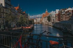 Amsterdam (Mark Liddell) Tags: amsterdam holland thenetherlands netherlands nederlands capital city europe travel water river canal dutch architecture bicycle traditional sunset buildings waterfront blue sky outdoors