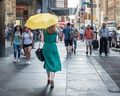 W 41st (John St John Photography) Tags: streetphotography candidphotography west41stst eighthavenue newyorkcity newyork thenewyorktimes woman youngwoman walking green dress yellow umbrella rain wet sidewalk color johnstjohnphotography portauthoritybusterminal
