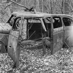 Suicide Doors of an Old, Decaying Plymouth (pmvarsa) Tags: spring 2018 analog bw blackandwhite film 120 mf 6x6 mediumformat ilford ilfordfp4plus fp4 125iso nikonsupercoolscan9000ed nikon coolscan cans2s mamiya c33 mamiyac33 classic camera tlr twinlensreflex mood rust car chrysler plymouth decay abandoned derelict suicide doors auto body trees leaves forest woods trail moraine art waterloo ontario canada