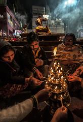 Prayer on Fire (swati.mallik) Tags: varanasi people faith ganga prayer light