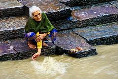 Elderly woman splashing water on the banks of the Bagmati River at the Shree Pashupatinath Temple, Kathmandu, Nepal (BryonLippincott) Tags: nepal asia asian centralasia pashupatinath kathmandu nepalese nepali southernasia outside outdoors day daytime travel destination old ancient oriental building temple architecture exterior facade traditional culture heritage history historic hindu hinduism religious religion placeofworship sacred faith tourism touristattraction people group ceremony burial gather fire smoke pashupatinathtemple water river man family
