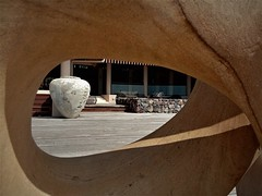 through the eye (SM Tham) Tags: asia southeastasia malaysia pahang cherating chendor thekasturi resort clubhouse building sculpture hole opening frame jar pot fountain water sandstone timber deck
