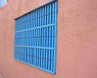 Blue window shade on adobe