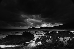 Dark Sky and Shoreline_Maui (Ken'sKam) Tags: sky clouds sea overcast rocks lavarocks surf mountains ocean shoreline nature weather dark bw blackandwhite monochrome maui hana hawaii bay trees coast water rock mountain sunset