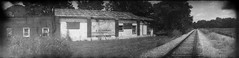 Glasgow Video & Outdoors Fishing & Hunting Supplies panorama (efo) Tags: film bw glasgow virginia closed business videooutdoors railroad mysteriouscamera agfavista800