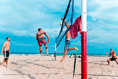 aggressive tape slut (VBuckley.com) Tags: beach beachvolleyball volleyball sand lakemichigan milwaukee bradford bradfordbeach redwhiteandblue doubles longshadows shadows sunset fun people 35mm canon glimpseofmilwaukee summer summervibes spike tape jump block american americana