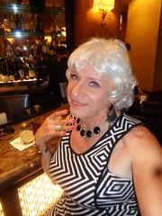 Smiling Lady (Laurette Victoria) Tags: cocktail bar milwaukee pfisterhotel woman laurette necklace silver dress