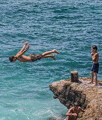 Teens Diving Off Rocks on Beirut's Rocky Shore (stevebfotos) Tags: water lebanon topaz beirut diving teens mediterraneansea rocks beirutgovernorate lb