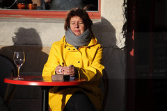 Soak up the sun (Elios.k) Tags: horizontal outdoors people oneperson woman café coffee drinkingcoffee enjoyingthesun moment sunshine wintersun outside alone sunbathing yellowraincoat colourful dof depthoffield neckwarmer winter cold sittingatcafé claspingcupofcoffee shadow wall glassofwine colour color travel travelling november2017 canon 5dmkii photography ghent gent belgium belgique flanders flemishregion europe tea tearoom callisto