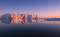 Floating amongst the icebergs in Greenland was a magical experience. Where the sun sets at midnight, giving us this beautiful golden glow. Enjoy. #Greenland #ilulissat #icebergs #Nikon (mitalpatelphoto) Tags: instagram greenland icebergs glacier ocean water landscape nature earth sailboat boat europe