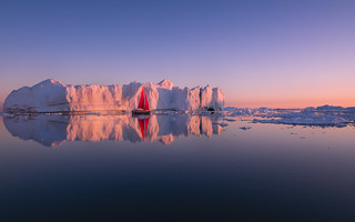 Floating amongst the icebergs in Greenland was a magical experience. Where the sun sets at midnight, giving us this beautiful golden glow. Enjoy. #Greenland #ilulissat #icebergs #Nikon