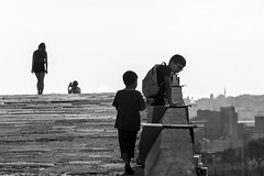 a day on the bridge / curiosity is a splendid thing (Özgür Gürgey) Tags: 70300mm bw büyükçekmece d750 nikon architecture bridge people silhouette sky stone street istanbul