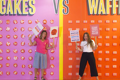 Fake News at the Hall of Breakfast (aaronrhawkins) Tags: breakfast debate controversy pancake waffle versus fight picket sign rage angry argue news fake colorful divide dividingline hallofbreakfast saltlakecity girls women bright pink orange support kellie jessica false faux aaronhawkins yell shout scream mad artificial