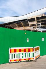 A Library Composition 2 (pni) Tags: oodi ode fence green plastic red yellow safetystripe white sign building pavement library kirjasto bibliotek sky cloud helsinki helsingfors finland suomi pekkanikrus skrubu pni this