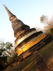 wat in  chiangmai , Thailand (www.icon0.com) Tags: thailand mai chiang travel wat doi suthep traveler site outdoor chiangmai pilgrimage oriental tropical bells statue landmark attraction buddhist chedi vertical top traditional carved stupa buddhism asia spirituality tourist thai monks decorative hilltop architecture gold color temple mountain sky religion buddha meditate monument exotic spires southeast asian
