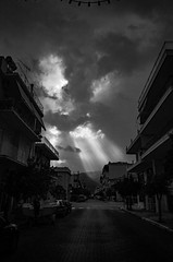 ricoh-0014029 (PanosKa) Tags: blackwhite bw clouds sunlight sunbeam itea ricohgrii