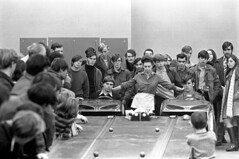 011071 26 (ndpa / s. lundeen, archivist) Tags: nick dewolf nickdewolf blackwhite blackandwhite 35mm film photographbynickdewolf bw january 1971 1970s boston massachusetts carshow slotracing slotcars people crowd men youngmen modelcars slotcarracing dragstrip game table display amusement dragracing racetrack track slots console consoles driver drivers race children kids boys woman cars starter