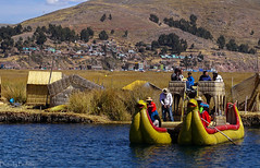 On floating islands / На плавучих островах (Vladimir Zhdanov) Tags: travel peru andes altiplano titicaca lake water sky mountains tree puno landscape boat people settlement urosislands grass