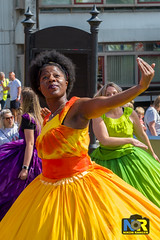 Wigan Pride 2018. (Nikon Ranger) Tags: red wigan pride wiganpride2018 nikonranger nikond3s nikon 2470 lbgt lbgtq colorful street people parade rainbow colour color outside outdoors 2018 flowerpower dancer orange