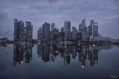 Cloudy Day in the Lion City (Karnevil) Tags: asia singapore lioncity downtowncore marinabay cityscape skyline skyscrappers bay water reflections cloudy morning longexposure outdoors earlymorning bluehour blue lheurebleue wideangle wideanglelens nikonlens fotodiox lensadapter sony a7rii a7 rii petekreps