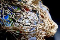 Fisch im Netz / Fish in the net (ingrid eulenfan) Tags: macromondays makro macro mesh netz fischdose fishtin stilllife stillleben sonya77ii tamronsp90mm