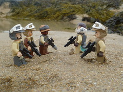 Rebel Rendezvous. (Working hard for high quality.) Tags: sand sea beach water seaweed rockpool seaside ocean lego star wars rebel alliance trooper recon operation science fiction