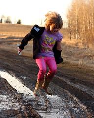 Splashing in Mud (C.A.Johnston) Tags: mud splash country road fun smile happy play alberta canada rubberboots
