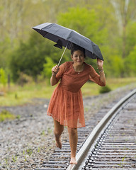 Rainy Day Fun (vtcollins) Tags: portrait fun break fashion photoshoot rainy day impromptu railroad tracks spring barefoot umbrella colorful green orange red dark